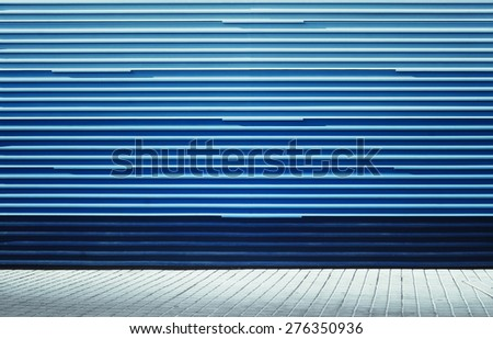 Aged street blue wall background texture - stock photo