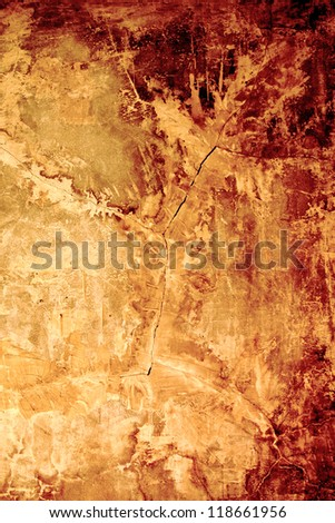 Aged, super-textured background with cracks in golden-rusty (autumn) colors. Faded area for copy space. - stock photo