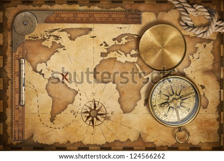 aged treasure map, ruler, rope and old brass compass with lid - stock photo