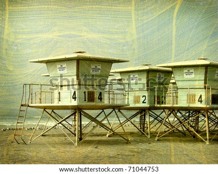 Aged vintage photo of lifeguard tower on beach - stock photo