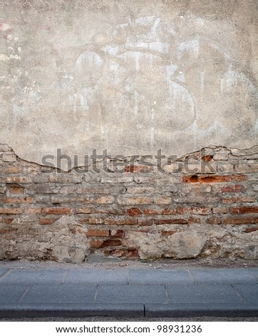 Aged weathered street wall background - stock photo