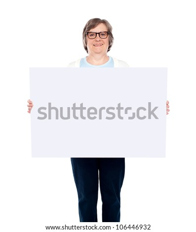 Aged woman displaying blank poster against white background - stock photo
