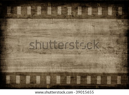Aged wood texture with  film strip - stock photo