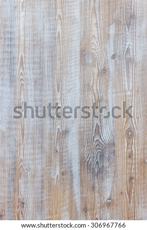 Aged wooden background of weathered distressed rustic wood boards with faded light blue paint showing brown woodgrain texture - stock photo