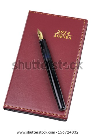 Agenda 2014 leather notebook and pen isolated on the white background  - stock photo