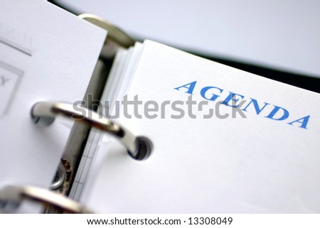 "Agenda planner closeup, focus on word ""agenda"" - stock photo"