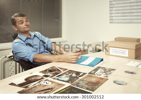 Agent in interrogation room - stock photo