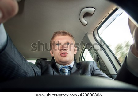Aggression behind the wheel, the driver is surprised while driving