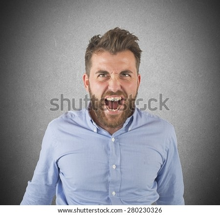 Aggressive businessman stressed out from work screams - stock photo