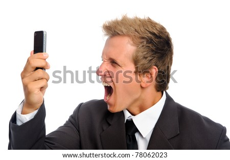 Aggressive man in business suit shouting into his mobile phone - stock photo