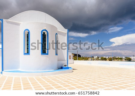 Agia Paraskevi, traditional Greek church located in the center of Pollonia village. Milos island, Cyclades, Greece.
