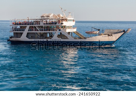 AGIA ROUMELI, CRETE GREECE - SEPTEMBER 30. Ferry in Agia Roumeli at the south coast of Crete on September 30, 2014. Samaria trail terminates here. All tourists have to go back by ferry - stock photo