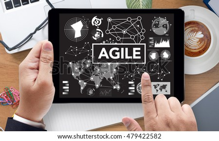 Agile Agility Nimble Quick Fast Concept, on the tablet pc screen held by businessman hands - online, top view