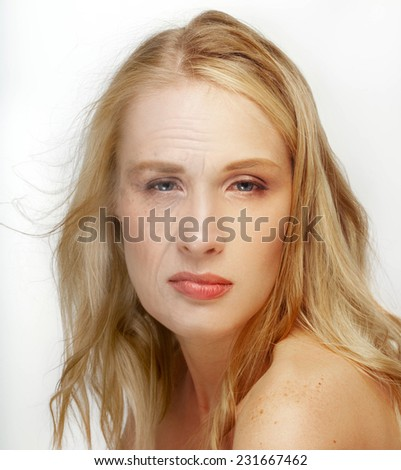 Aging and Skin care concept. Face of young woman and old woman with wrinkles isolated on white background. The same young and old face. Same Person in her Youth and old age - stock photo