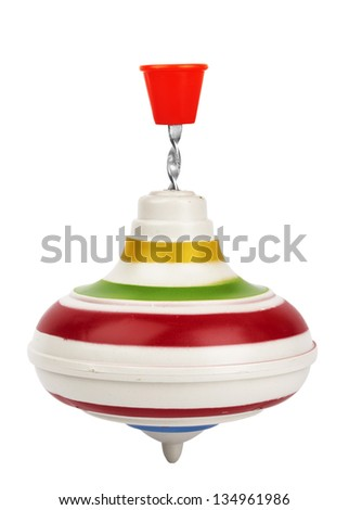 Aging plastic nursery whirligig with red handle on white background - stock photo
