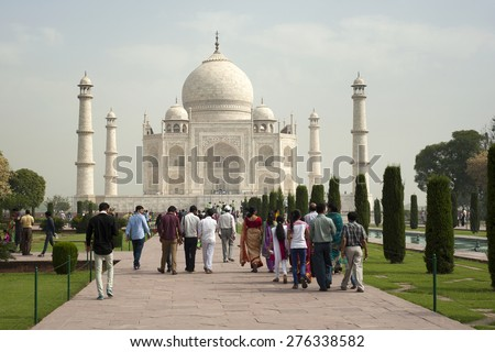 AGRA, INDIA - APRIL 23,2015: Taj Mahal Mousoleum in Agra on April  23, 2015. Taj Mahal was built by Mughal emperor Shah Jahan in memory of his third wife, Mumtaz Mahal. - stock photo