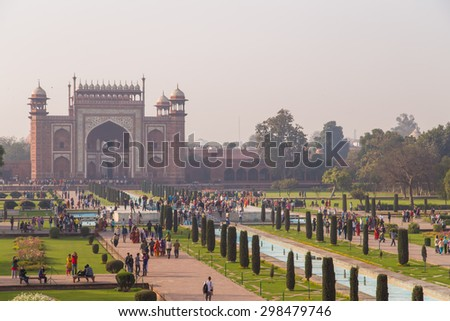 AGRA, INDIA - 28 FEBRUARY 2015: AGRA, INDIA - 28 FEBRUARY 2015: View of North side of Great Gate from Taj Mahal with visitors. - stock photo