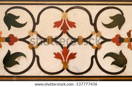 AGRA, INDIA - FEBRUARY 14: Mughal stone art on the facade of the Taj Mahal (Crown of Palaces), an ivory-white marble mausoleum on the south bank of the Yamuna river in Agra, India on February, 14,2016