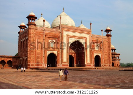 AGRA, INDIA - JULY 19, 2015: The people visit to red tower of Taj Mahal complex. It is one of the biggest tourist highlights.Uttar Pradesh, India. JULY 19 2015