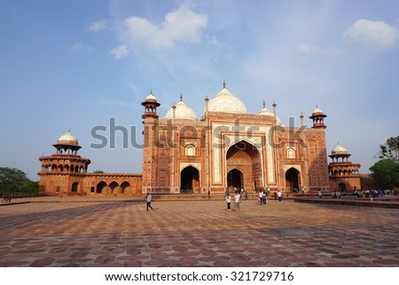 AGRA, INDIA - JULY 19, 2015. The people visit to red tower of Taj Mahal complex. It is one of the biggest tourist highlights in Uttar Pradesh, India.