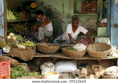 AGRA, INDIA - JUNE 17: Market. Most common health risks in India are hep B and typhoid, the main source being contaminated unclean food, same as sold on this market on June 17, 2007 in Agra, India. - stock photo