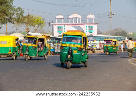 AGRA,INDIA - March 25,2013 : Rickshaw  ( tuk tuk )is one of the most important transportation vehicles in India. - stock photo