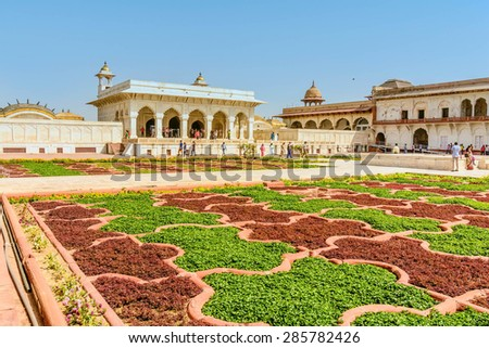 Agra, India- March 9, 2015: Tourist going in Agra Red Fort, a Unesco World Heritage site, and one of the biggest tourist highlights, just 2 km of Taj Mahal. - stock photo