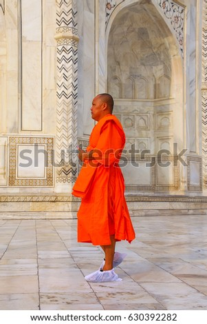 AGRA, INDIA - NOVEMBER 9: Unidentified man stands otside of Taj Mahal on November 9, 2014 in Agra, India. Taj Mahal was designated as a UNESCO World Heritage Site in 1983.