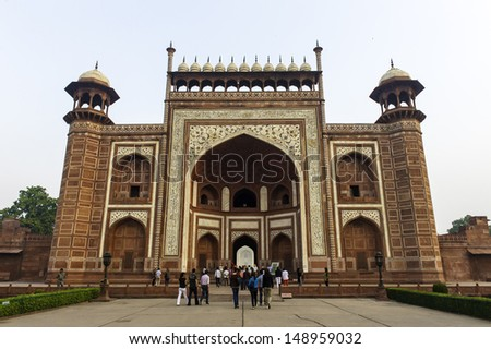AGRA, INDIA - OCTOBER 24: The people visit Taj Mahal, Agra, India on October 24, 2012. The Taj Mahal is a mausoleum located in Agra, India and is one of the most recognizable structures in the world