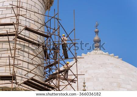 Agra, Uttar Pradesh, India - December 19, 2015: Restoration work in the Taj Mahal complex on December 19, 2015, in Agra, Uttar Pradesh, India. - stock photo