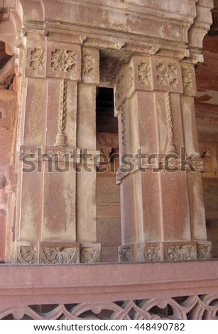 Agra, Uttar Pradesh, India - October 2011: Columns of a monument in the Fatehpur Sikri Palace, a UNESCO World Heritage. - stock photo