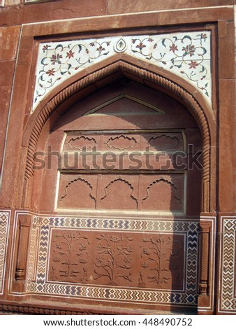 Agra, Uttar Pradesh, India - October 2011: Decorations of entrance of the Taj Mahal. - stock photo