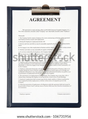 Agreement paper with a pen in a clip-board - stock photo