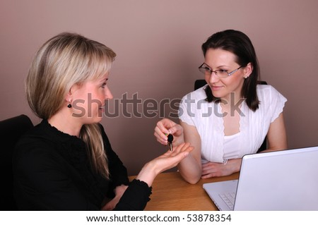 Agreement two business woman in office - stock photo