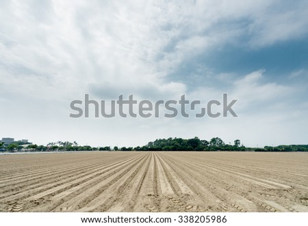 Agricultural Background Of Newly Plowed Field Furrows Ready For New Crops