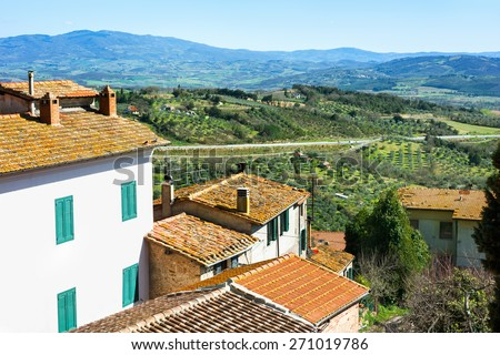 Agricultural landscape with red roofs of houses in old village. Toscana, Italy. - stock photo