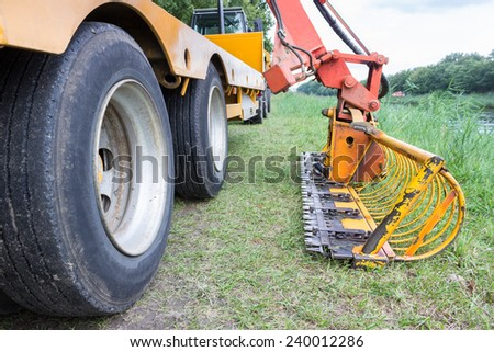 Agricultural machine for removing water plants in channel - stock photo