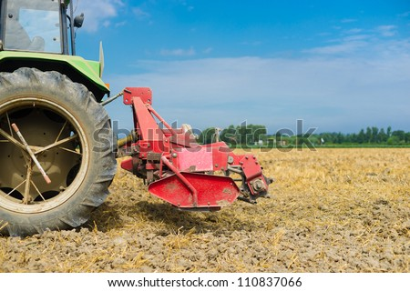 agricultural machinery on farmland - stock photo