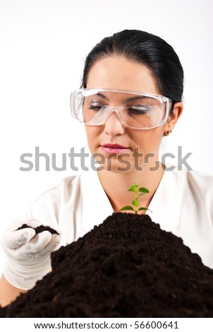 Agricultural scientist woman check soil and smile in a laboratory