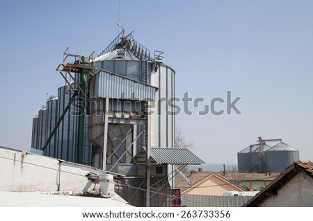 Agricultural silos and buildings - stock photo