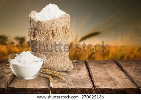 Agriculture. Whole flour in bag with wheat ears - stock photo