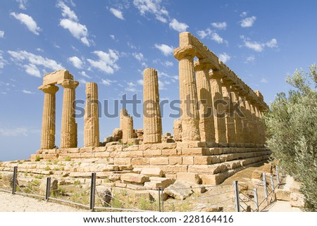 AGRIGENTO, ITALY - JULY 14: Temple of Juno, a Greek temple of 450 BC located in the Valle dei Templi, on July 14, 2013, in Agrigento, Sicily, Italy. - stock photo