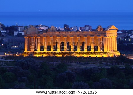 Agrigento, Sicily: ancient temple of Concordia in Valley of Temples, unesco world heritage in Italy at twilight - stock photo