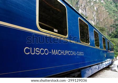 AGUAS CALIENTES, PERU - MARCH 14, 2015: Train connecting Cusco and Machu Picchu in Peru - stock photo