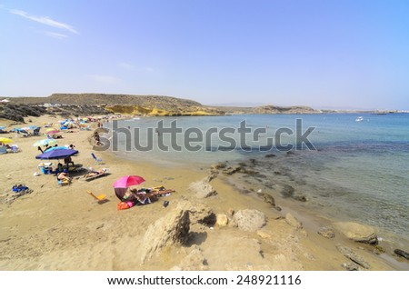 Aguilas, Spain - July 31 People enjoying on the beautiful beach of La Carolina in summer. Aguilas, Murcia July 31, 2012 - stock photo