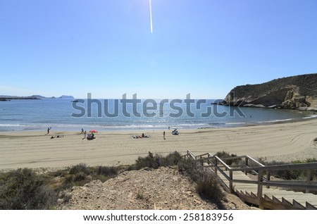Aguilas, Spain - June 09 People enjoying on the beautiful cove of La Carolina. Aguilas, Murcia June 09, 2013 - stock photo