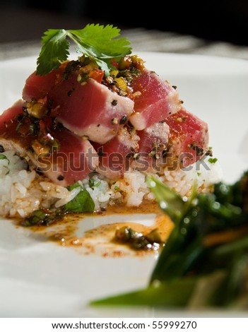 Ahi tuna over rice with stir fry vegetables - stock photo