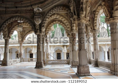 AHMEDABAD, GUJARAT, INDIA - AUGUST 21 : Hutheesing Jain Temple on August 21, 2012 in Ahmedabad. Colonnaded structure & ornamental  archs of ' Rangmandapa ', a hall for musical & dancing performances. - stock photo