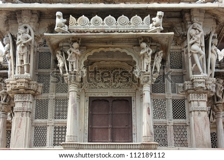 AHMEDABAD, GUJARAT, INDIA - AUGUST 21 : Hutheesing Jain Temple on August 21, 2012 in Ahmedabad. Amazing intricate stone carving work on veranda. Historic monument built in 1847 by Hathising Kesarising - stock photo