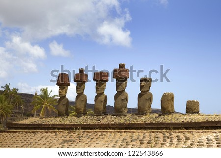 Ahu Nau Nau Moai Statues at Anakena Beach with red scoria headdress's, Easter Island, Chile. - stock photo